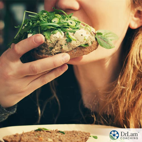 A woman chewing food properly