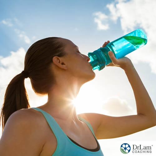 girl drinking water may be at risk for hyponatremia