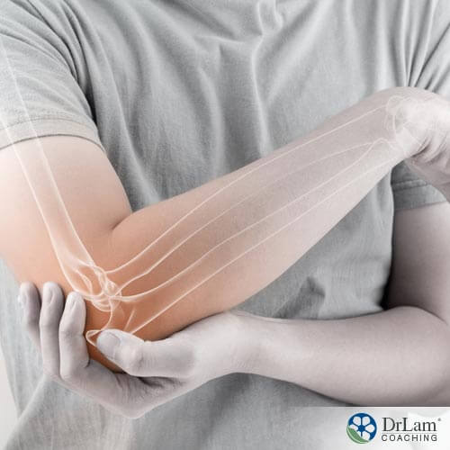 a man clutching his elbow preventing osteoarthritis