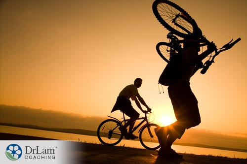 Person carrying bicycle to help Managing IBS