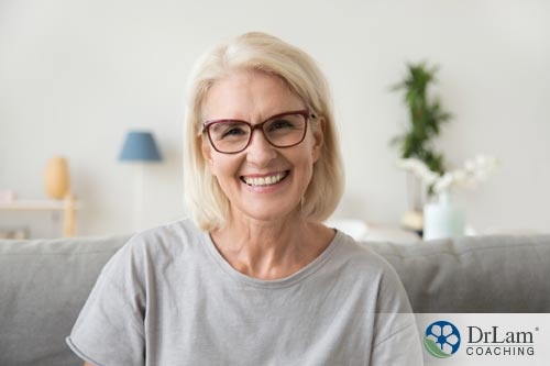 an image of an older woman smiling from eating high protein vegetarian food