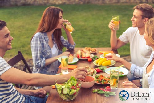 an image with four people enjoying a meal of high protein vegetarian food