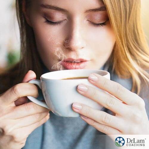 A young woman relieving stress with tea and caffeine