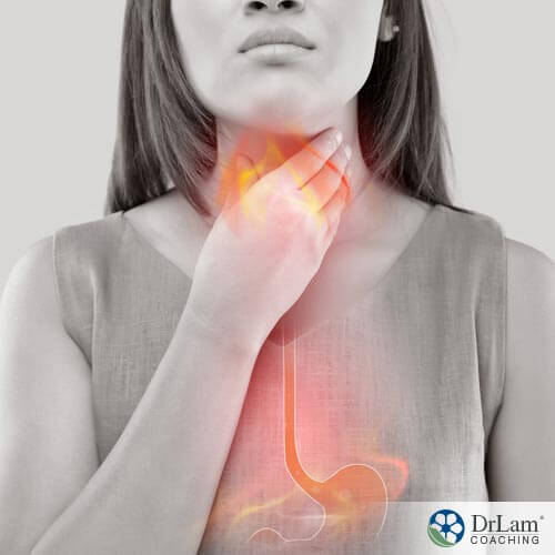 Woman suffering from GERD medications holding her throat