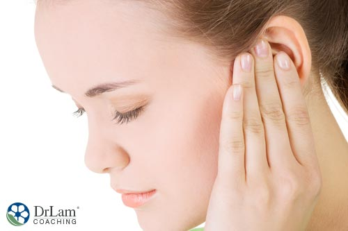 woman holding ear may have Meniere's Disease