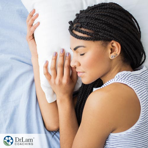 Young healthy woman pleasantly sleeping in bed with hormones and sleep patterns