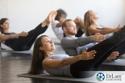 young woman in yoga class benefitting from plant-based diet