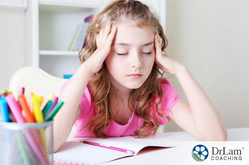 An image of a little girl who is stressed from getting teased and bullied