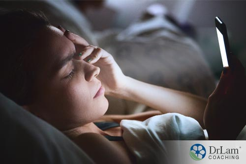 a woman in bed stressed out causing an alarm in the Neuroaffect circuit