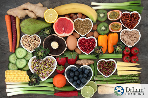 An image of a display of heart-healthy foods on a table with heart-shaped bowls