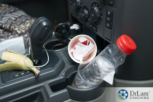 An image of a car's center console with trash all over it