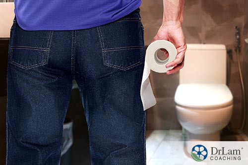 man with toilet paper preparing to use bathroom may benefit from vitamin d and ibs
