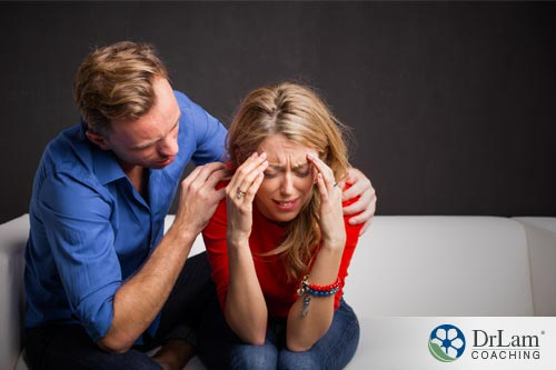 depressed woman being comforted by a man. she may see the benefits of ketamine