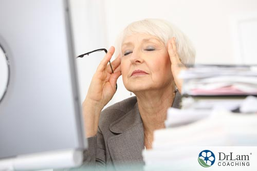 tired woman contemplating to delay menopause