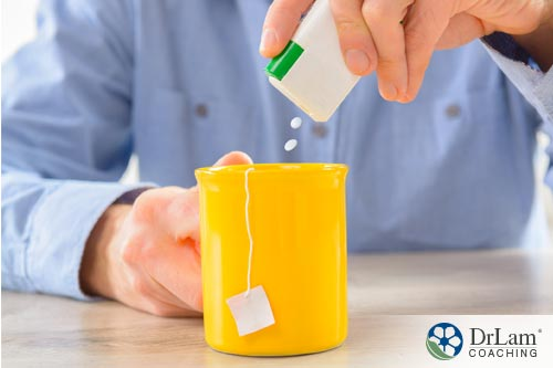 A man putting sweetener to his tea. The same ingredient used in diet soda