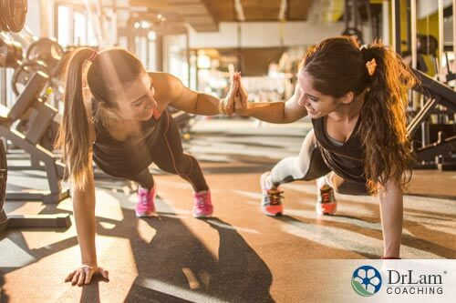 two women working on exercise and mental health