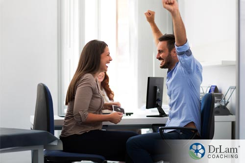 a man and woman celebrating the success of fertility supplements