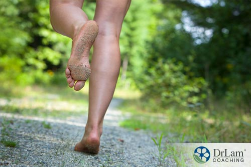 A woman going barefoot for grounding and vibrational living