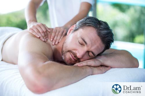 a man getting a massage to help relax his muscles from physical labor