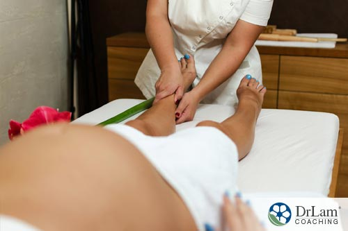 A pregnant woman having reflexology