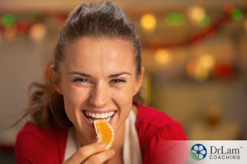 A woman eating orange to remedy bad breath