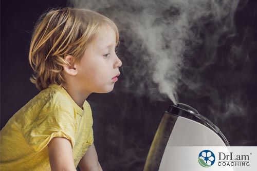 An image of a young child inhaling steam to help with sinus drainage