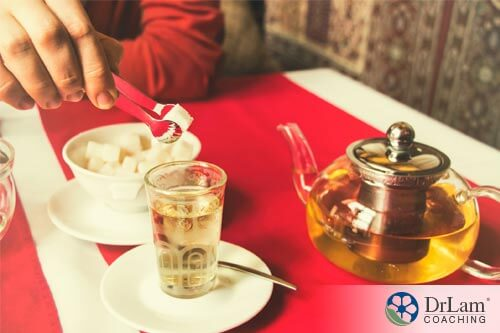 man putting sugar into his tea is not considering the effects of tea and epigenetics