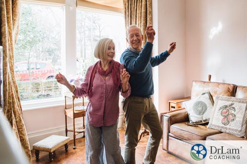 A senior couple gaining the health benefits of dancing