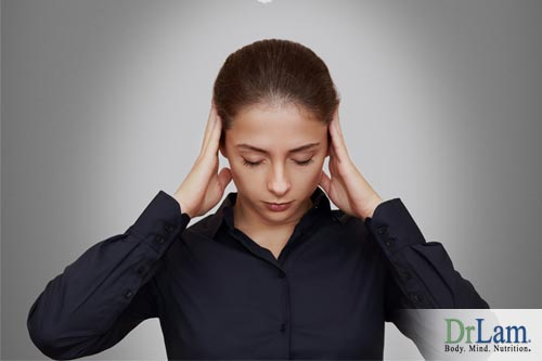 This woman is thinking hard but unable to recall something. Brain fog causes may be affecting her.