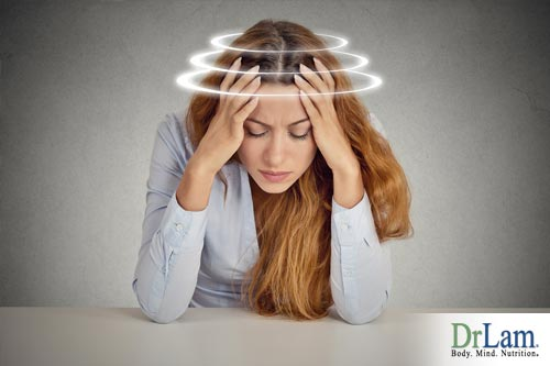 Woman suffering from a spinning head. What causes dizziness for her?