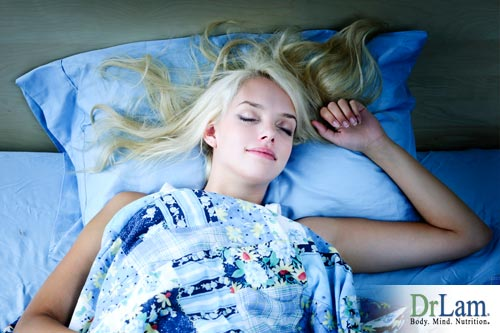 Young woman sleeping in bed, could she be getting too much sleep?