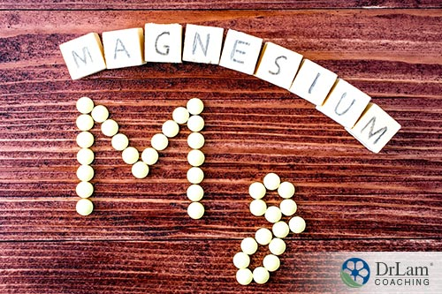 An image of magnisuem spelled out with scrabble letters above as well as dots below on a table