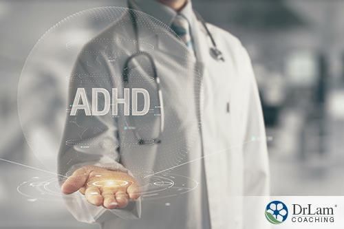 A doctor holding an ADHD hologram in his palm
