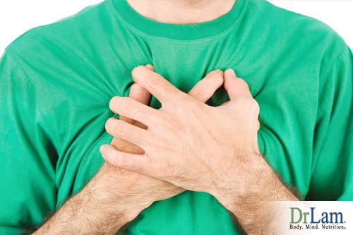 A man suffering from Breathlessness Causes and clutching his chest