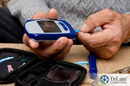 An image of someone using a blood sugar monitor