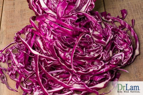 Red cabbage with half of it shredded, the main ingredient in braised red cabbage
