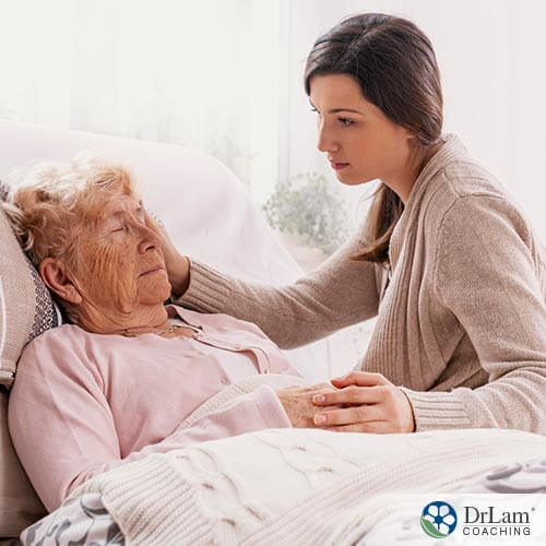Image of a caregiver taking care of a elderly lady