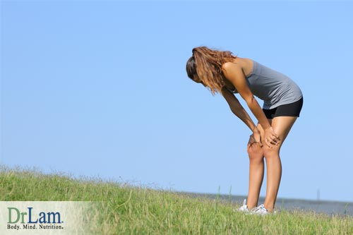 A woman tired from running which may be one of her causes of fatigue/