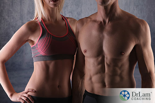 man and woman posing with their great body figure resulting from diet and exercise