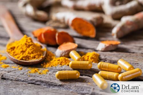 An image of Tumeric capsules, powder, and fresh