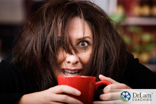 An image of a woman experiencing the negative effects of caffeine