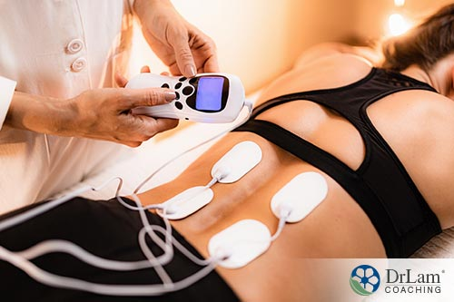 An image of a woman receiving electric therapy