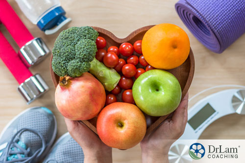 An image of a heart-shaped bowl holding heart-healthy food
