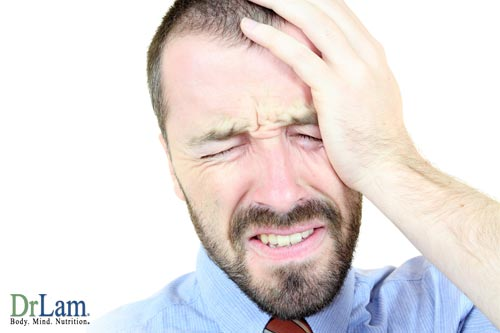 A man suffering a migraine which folic acid benefits may alleviate
