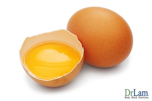 Two brown eggs, one of them cracked in half to reveal the liquid yolk resting in a half shell. The quality of protein in an egg is another of the health benefits of eggs.