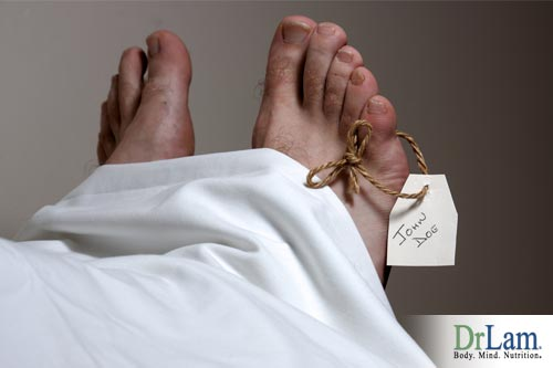 Feet with a coroner tag tied on, indicating the subject is dead, perhaps of heart illnesses