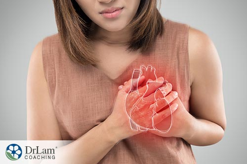 An image of a woman holding her heart