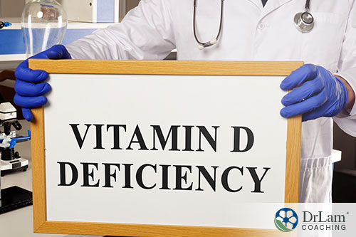 image of a doctor holding a sign of the word vit. d deficiency