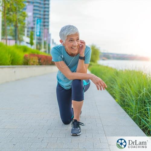 An image of an older woman who is enjoying some high intensity interval training along a river's walking path