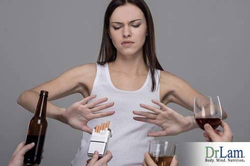 A young woman refusing alcohol and nicotene, one step in how to cleanse the liver.